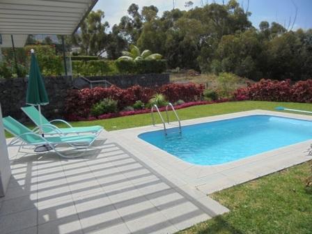 Modern villa with garden , pool and ocean views.