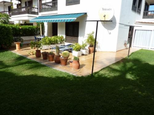 Квартира на первом этаже с садом и гаражом в верхнем месте