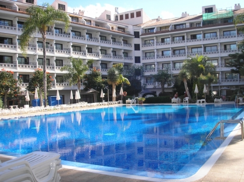 To live in a hotel complex with heated pool and beautiful garden